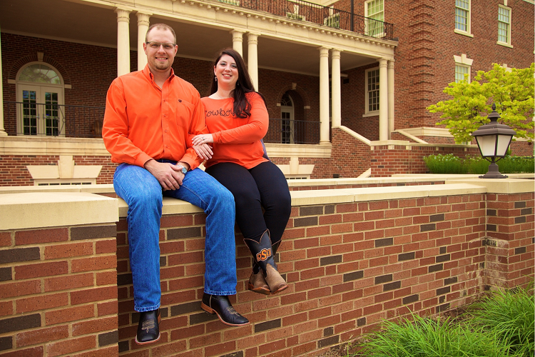 Photo of the Gossen's in front of Murray Hall